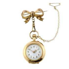 An open face fob watch. Yellow metal case with diamond