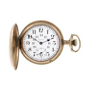 A full hunter pocket watch by Waltham. Gold filled