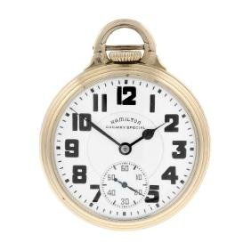 An open face railway grade pocket watch by Hamilton.