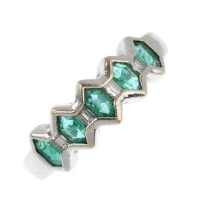 An emerald and diamond ring. The fancy-shape emerald