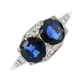 An Art Deco platinum sapphire and diamond dress ring.