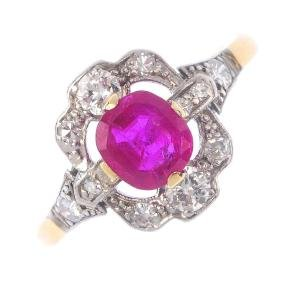 A Burma ruby and diamond cluster ring. The