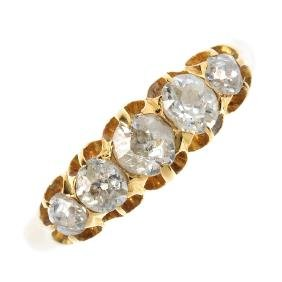 A late Victorian 18ct gold diamond five-stone ring. The