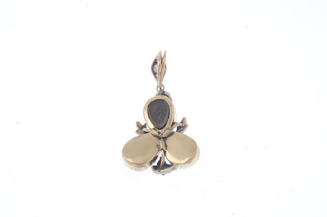 A garnet and diamond pendant. The pear-shape garnet - 2