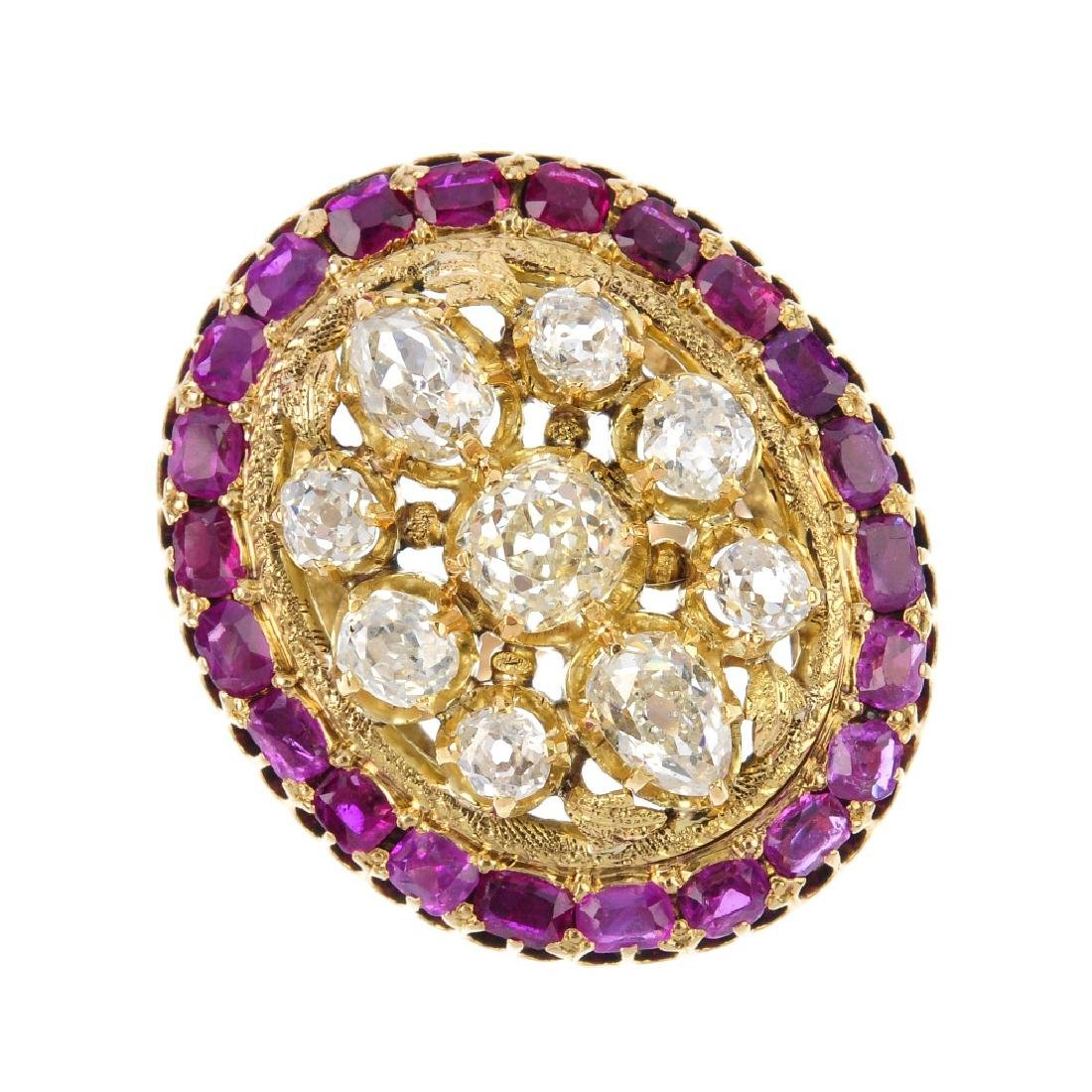 A diamond and ruby cluster ring. The vari-shape old-cut