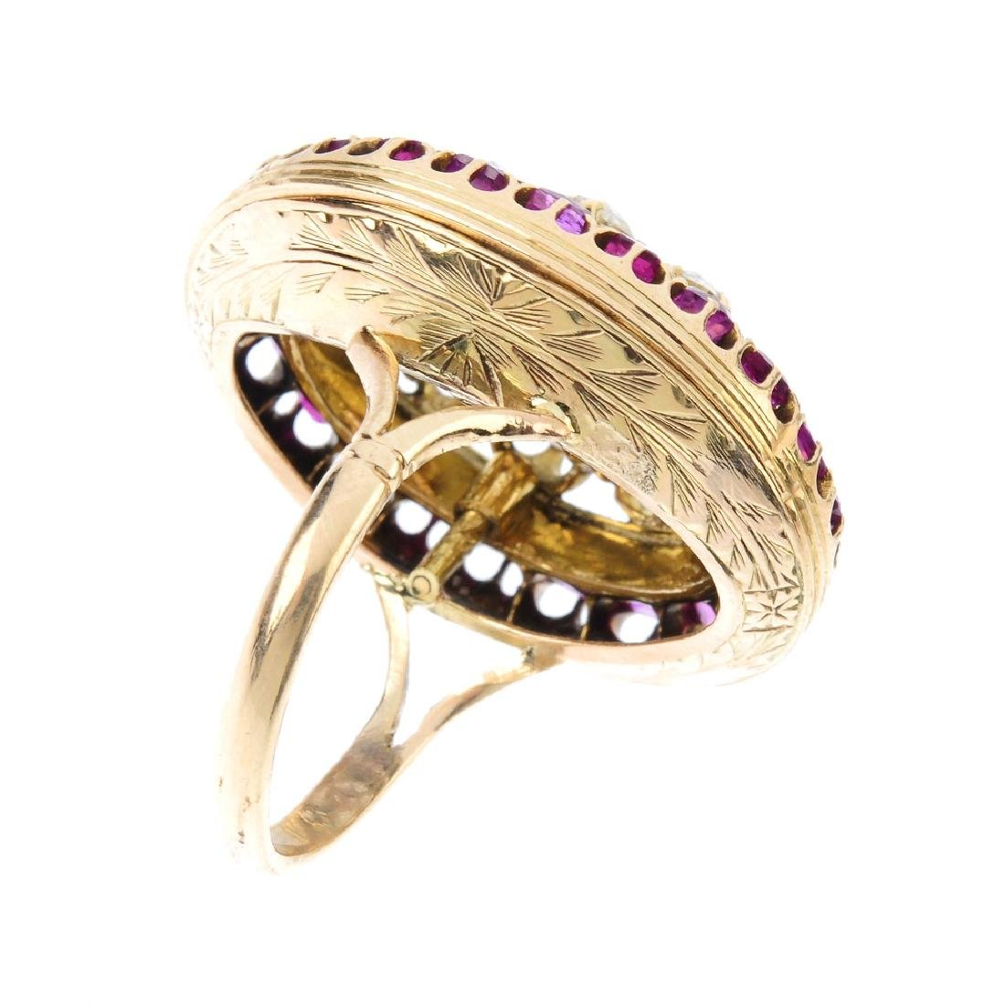 A diamond and ruby cluster ring. The vari-shape old-cut - 2
