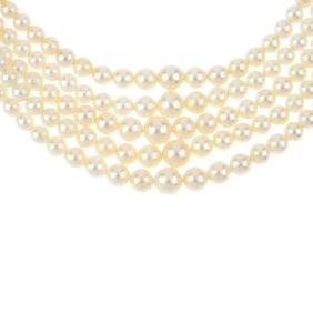 A cultured pearl multi-strand necklace. Comprising five