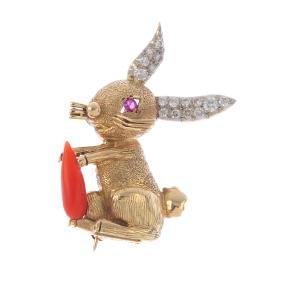 CARTIER - A 1970s diamond and gem-set rabbit brooch.