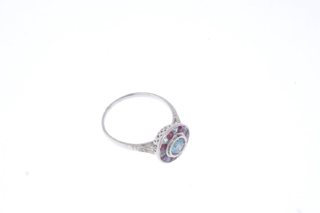 A 'coloured' diamond and gem-set cluster ring. The - 4