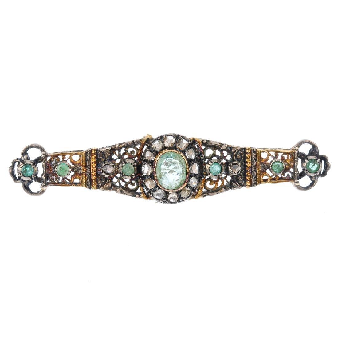 A beryl and diamond bar brooch. Of bi-colour design,