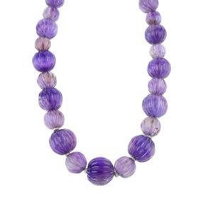 An amethyst bead necklace. Comprising a graduated