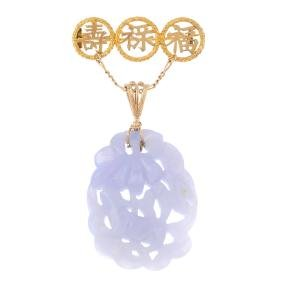 A jade brooch/pendant. The carved and pierced blue-lace