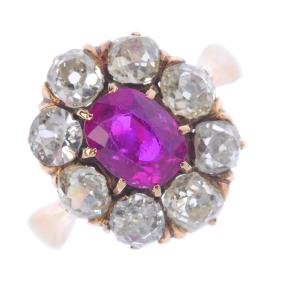 A Burma ruby and diamond cluster ring. The oval-shape