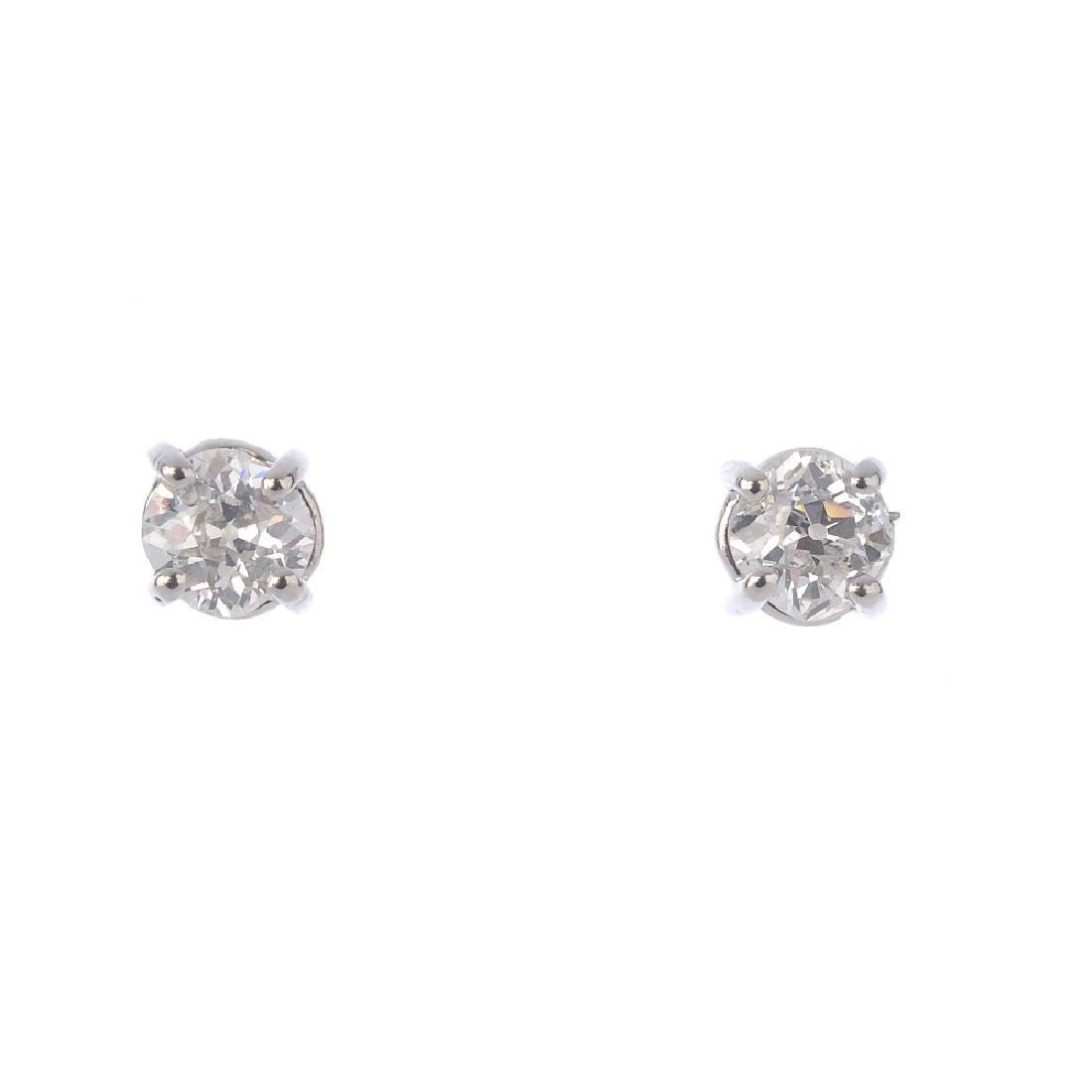 A pair of platinum old-cut diamond stud earrings.