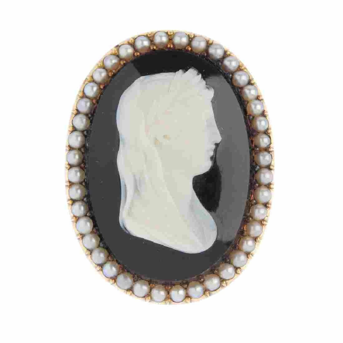 A late Victorian gold hardstone cameo pendant. Of oval