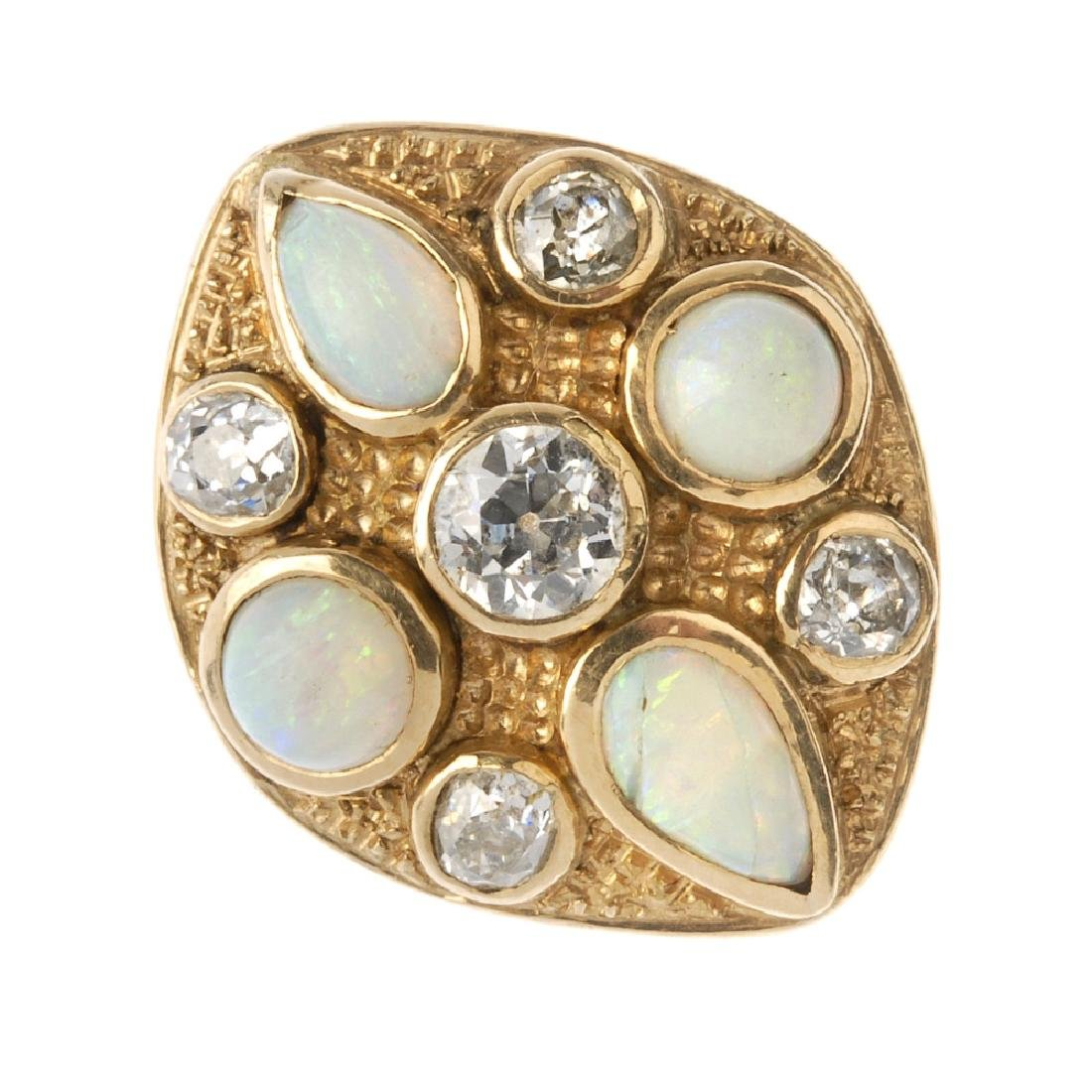 A diamond and opal dress ring. The marquise-shape