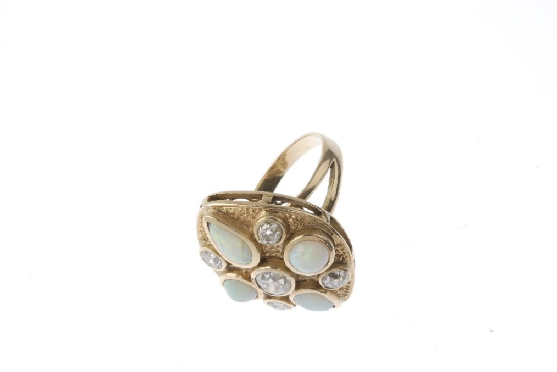 A diamond and opal dress ring. The marquise-shape - 2
