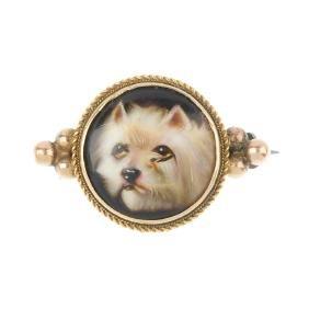 An enamel miniature brooch. The circular enamel painted