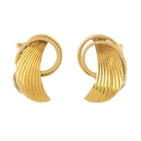 A pair of 1980s 18ct gold clip earrings. Each designed