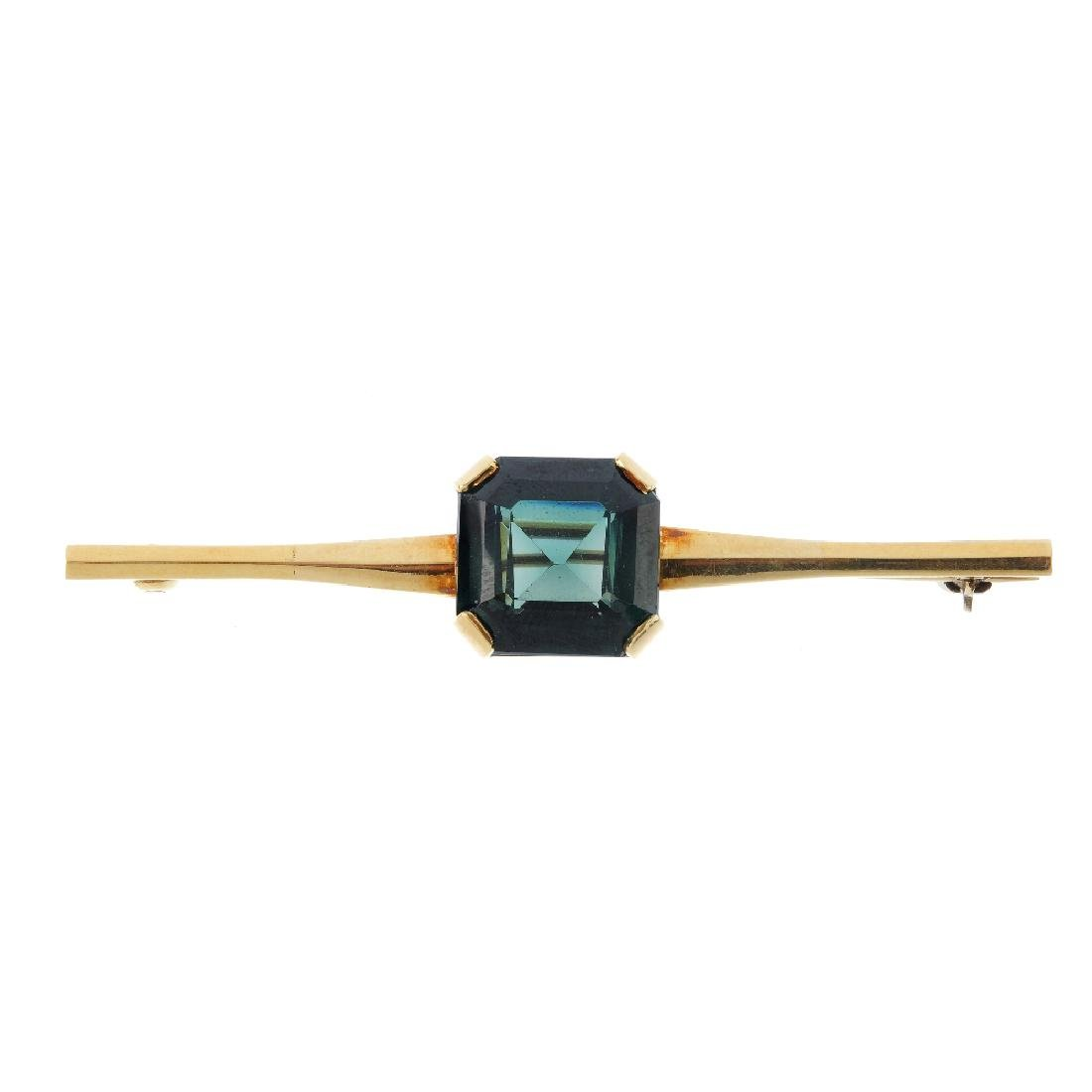 A synthetic spinel brooch. The rectangular-shape green