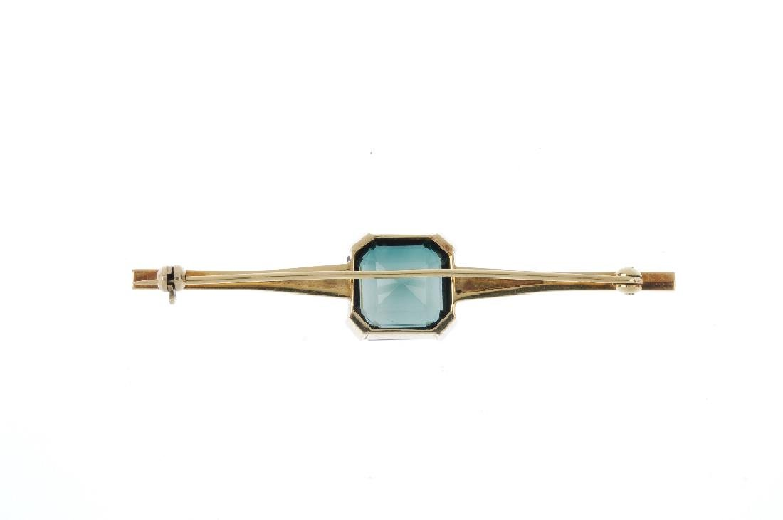 A synthetic spinel brooch. The rectangular-shape green - 2