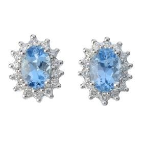 A pair of platinum aquamarine and diamond cluster