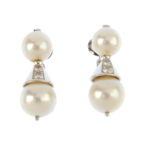 A pair of diamond and cultured pearl earrings. Each