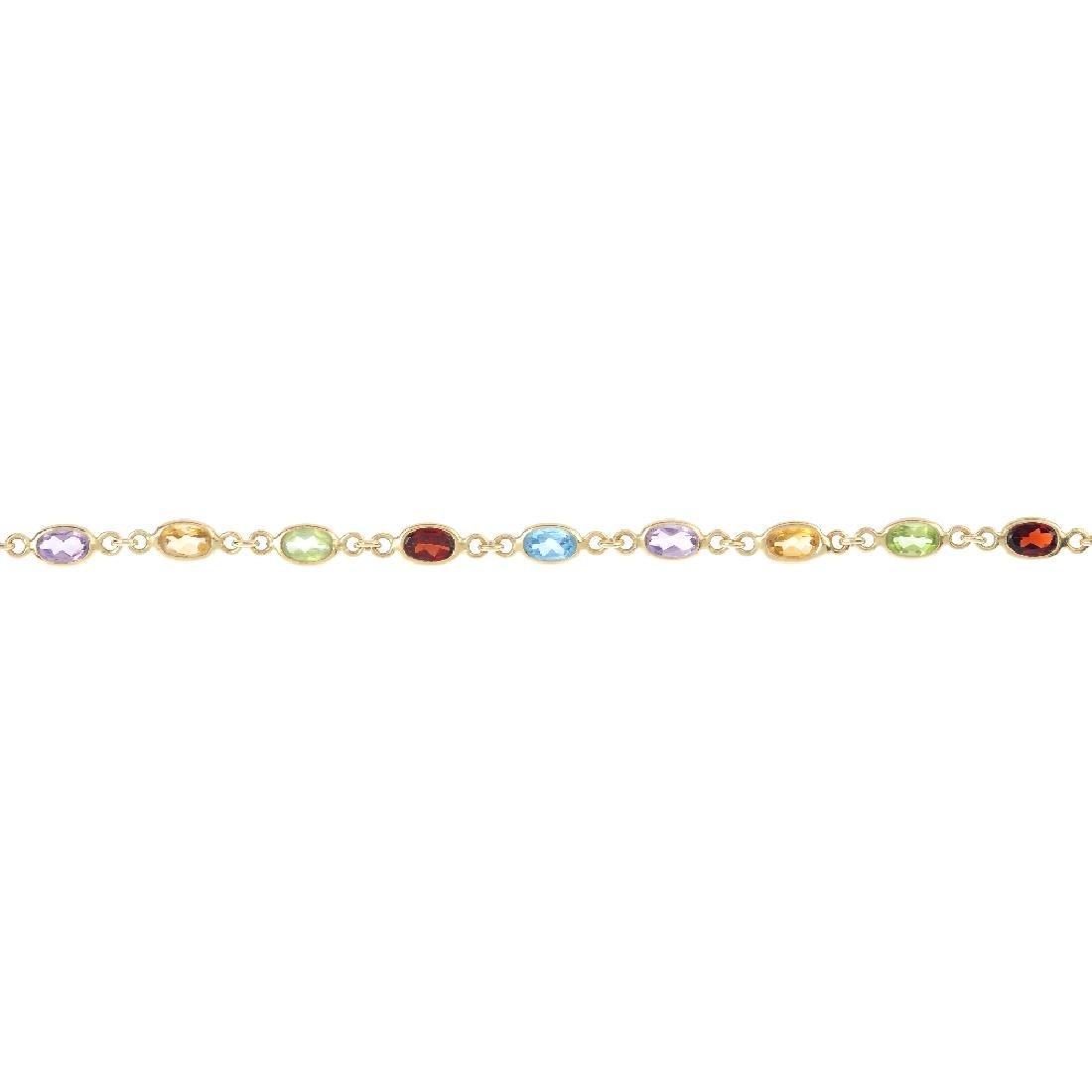 A bracelet and pair of earrings. The bracelet designed