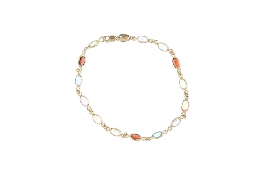 A bracelet and pair of earrings. The bracelet designed - 3