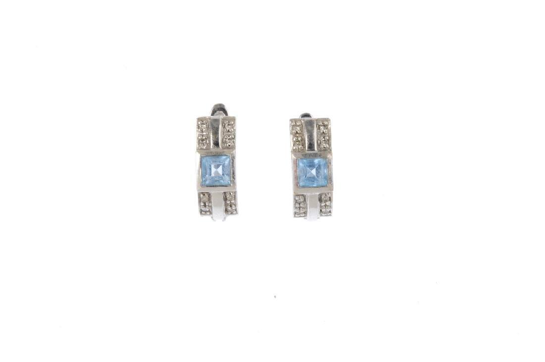 A bracelet and pair of earrings. The bracelet designed - 4