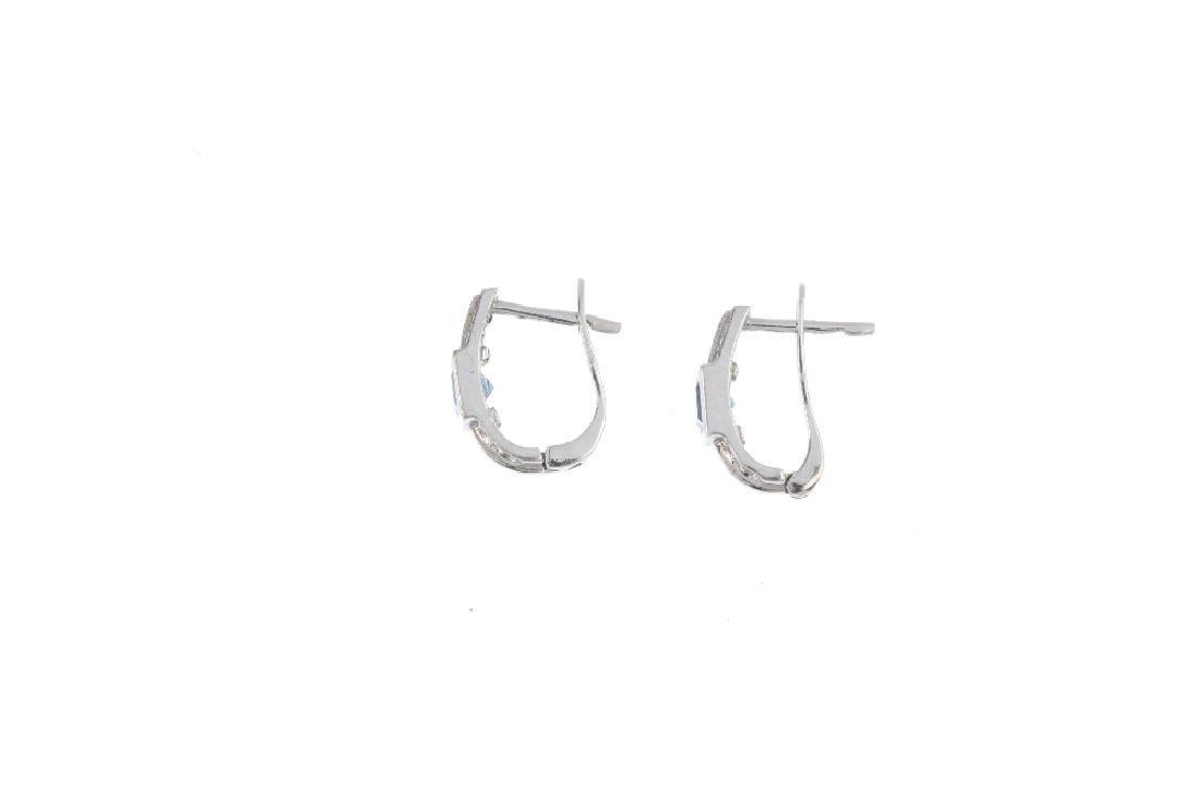 A bracelet and pair of earrings. The bracelet designed - 5