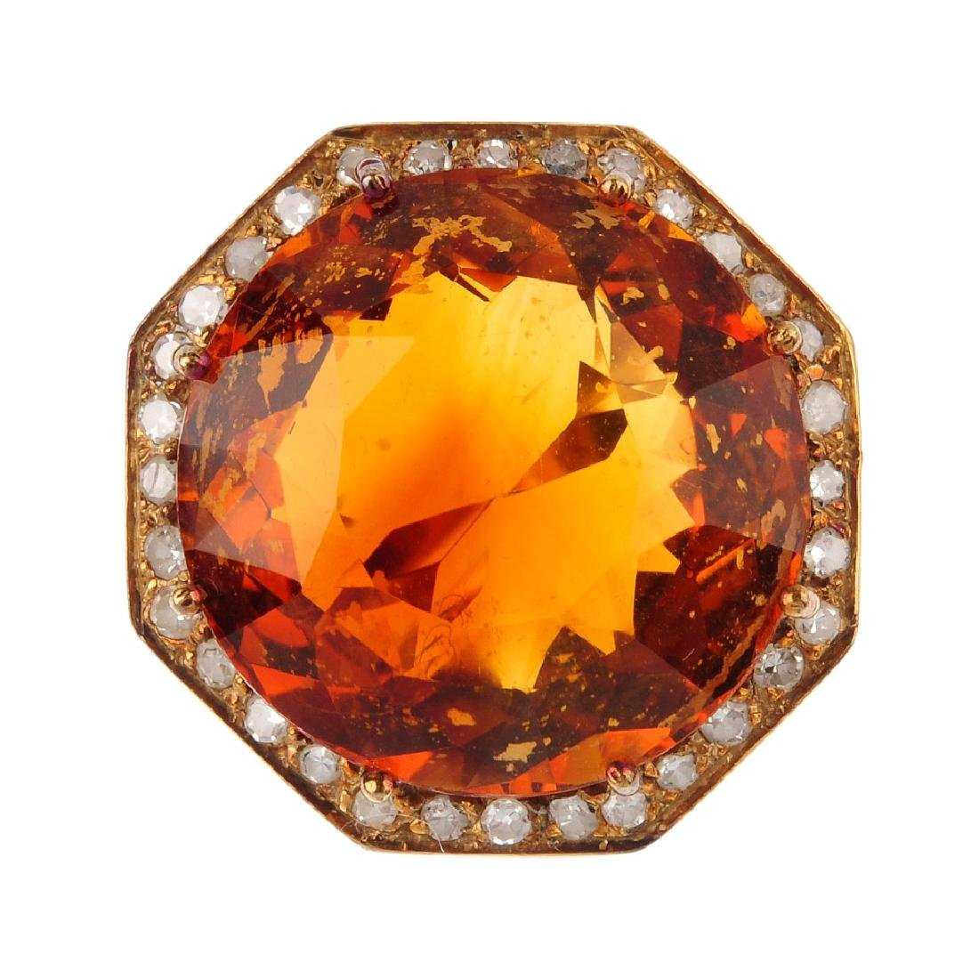A diamond and citrine dress ring. The circular-shape