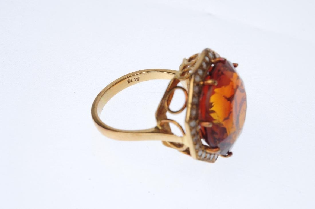 A diamond and citrine dress ring. The circular-shape - 3