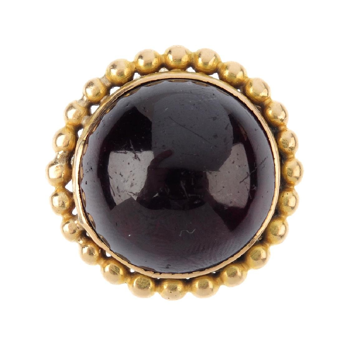 A garnet ring. The circular-shape cabochon, with