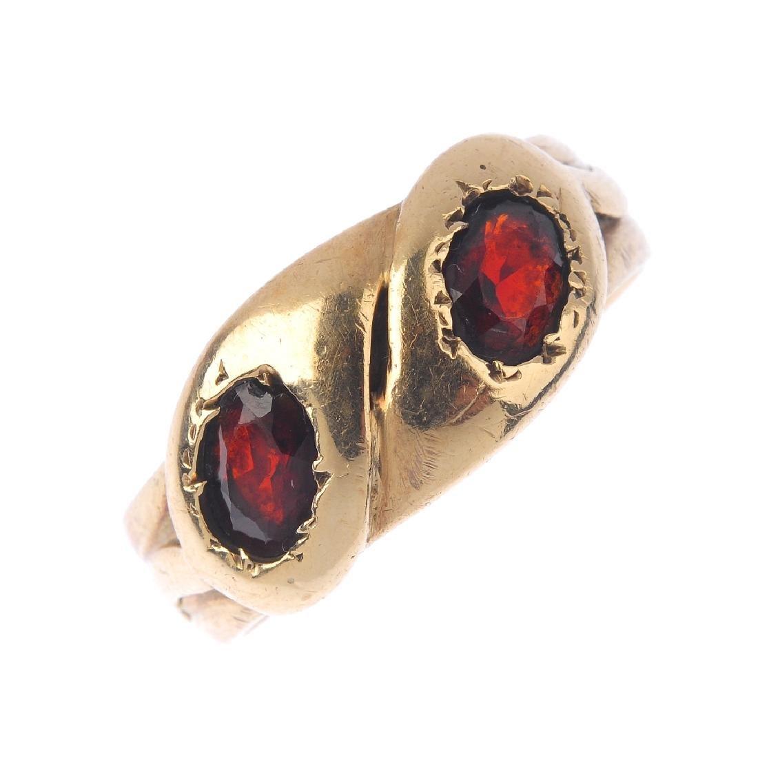 An early 20th century gold garnet snake ring.