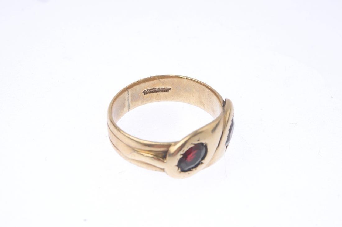 An early 20th century gold garnet snake ring. - 3