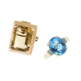 A brooch and a ring. To include a 9ct gold citrine