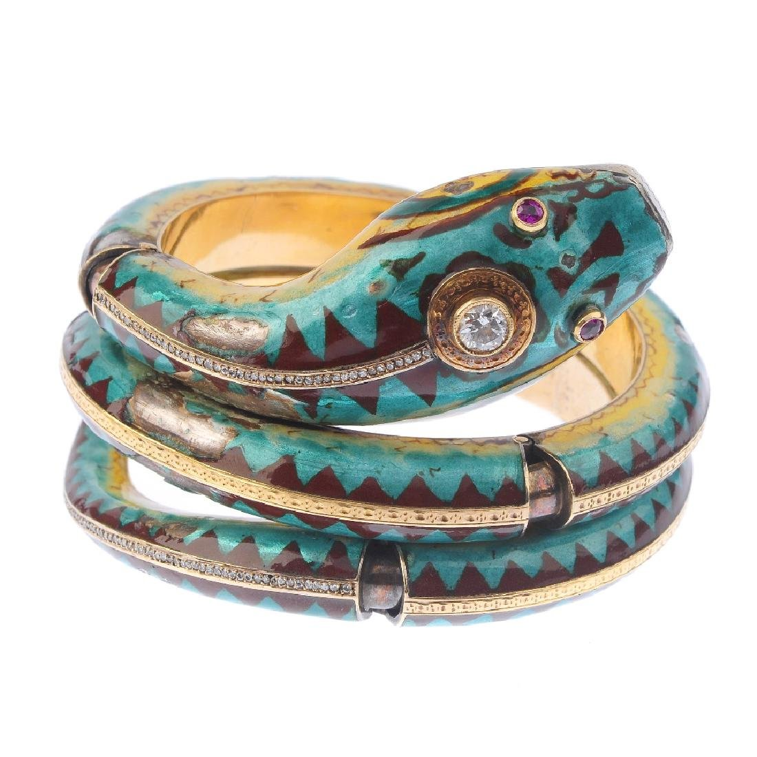 A diamond, ruby and enamel snake bangle. Of articulated