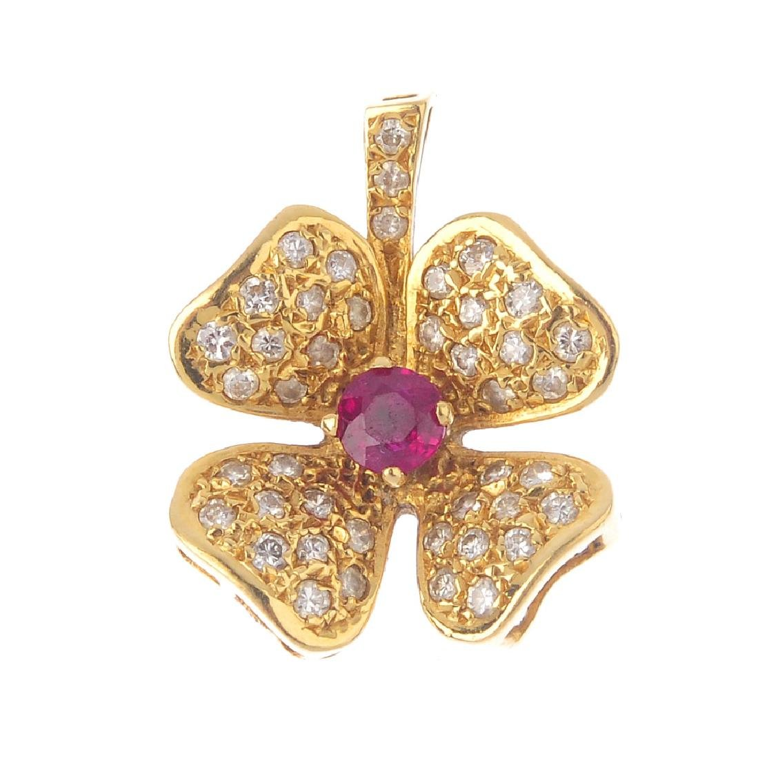 An 18ct gold diamond and ruby pendant. Designed as a