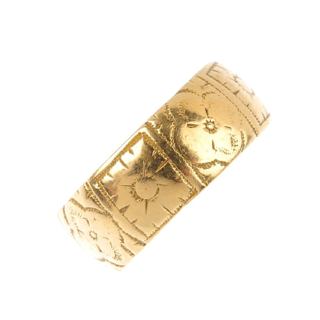 A late Victorian 18ct gold band ring. Engraved with a