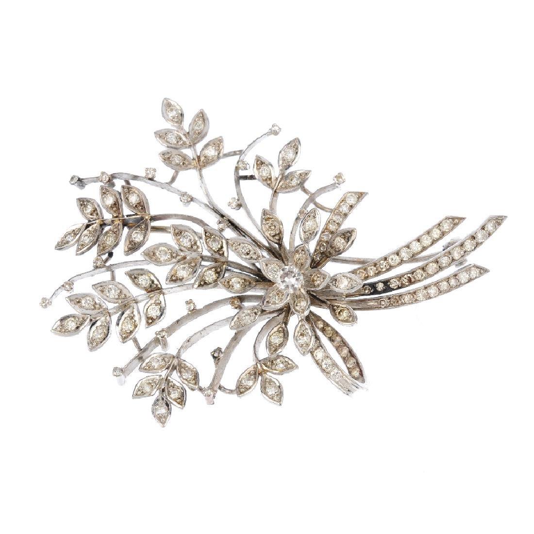 A diamond spray brooch. Of foliate design, the