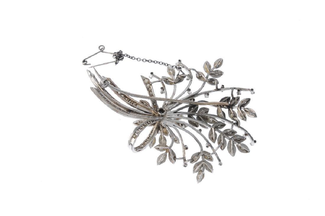 A diamond spray brooch. Of foliate design, the - 2