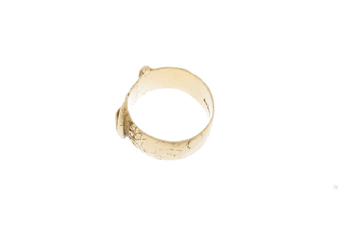 An early 20th century 18ct gold buckle ring. The floral - 2