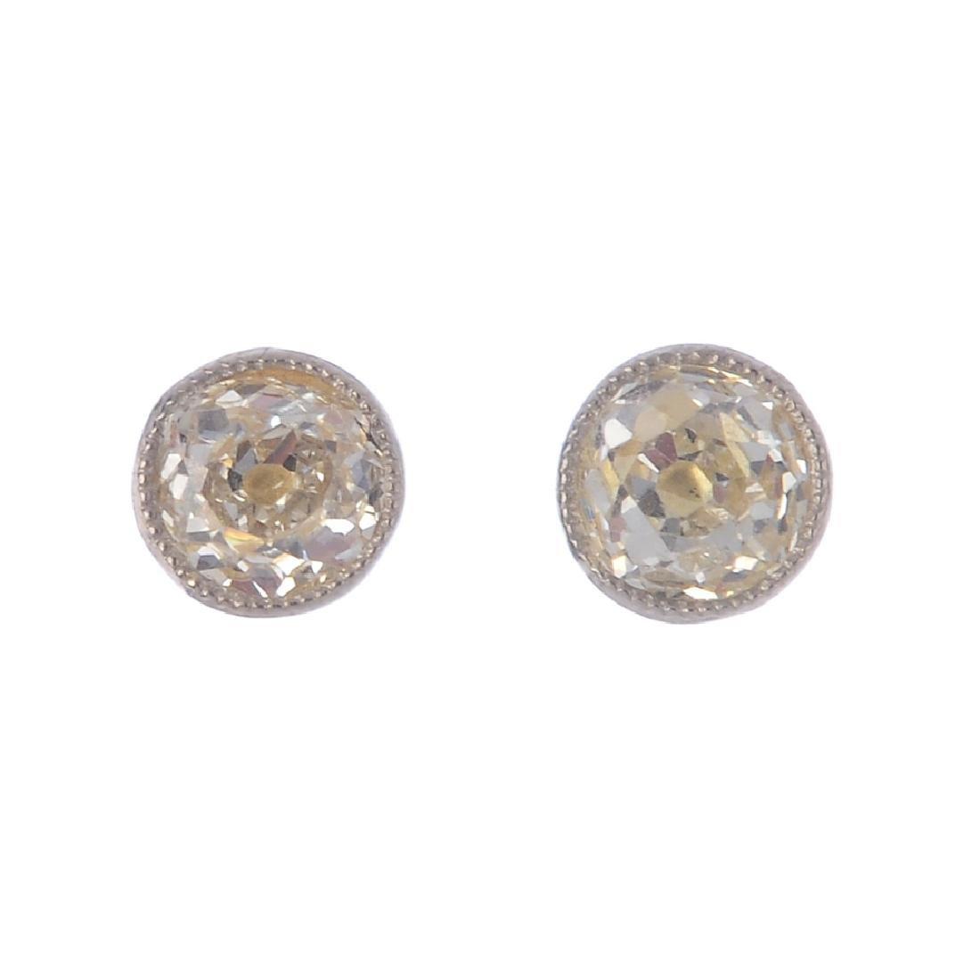 A pair of diamond stud earrings. Each designed as an