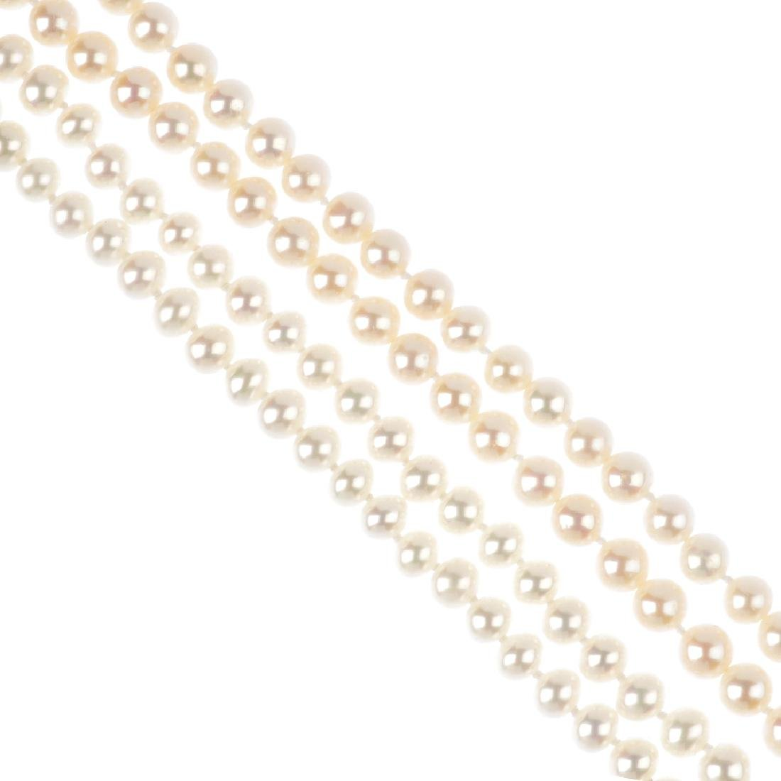 Four cultured pearl necklaces. Each designed as a