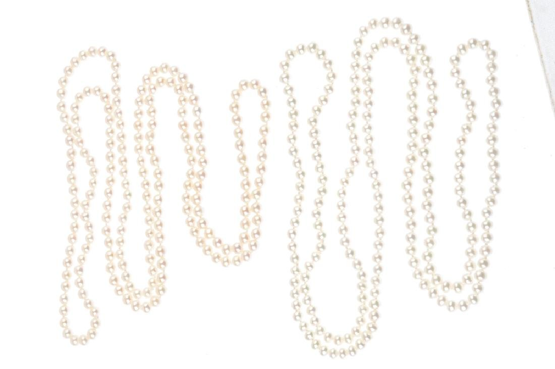 Four cultured pearl necklaces. Each designed as a - 2