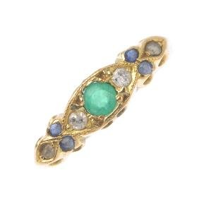 An 18ct gold emerald, sapphire and diamond dress ring.