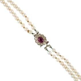 Two cultured pearl necklaces. To include a cultured