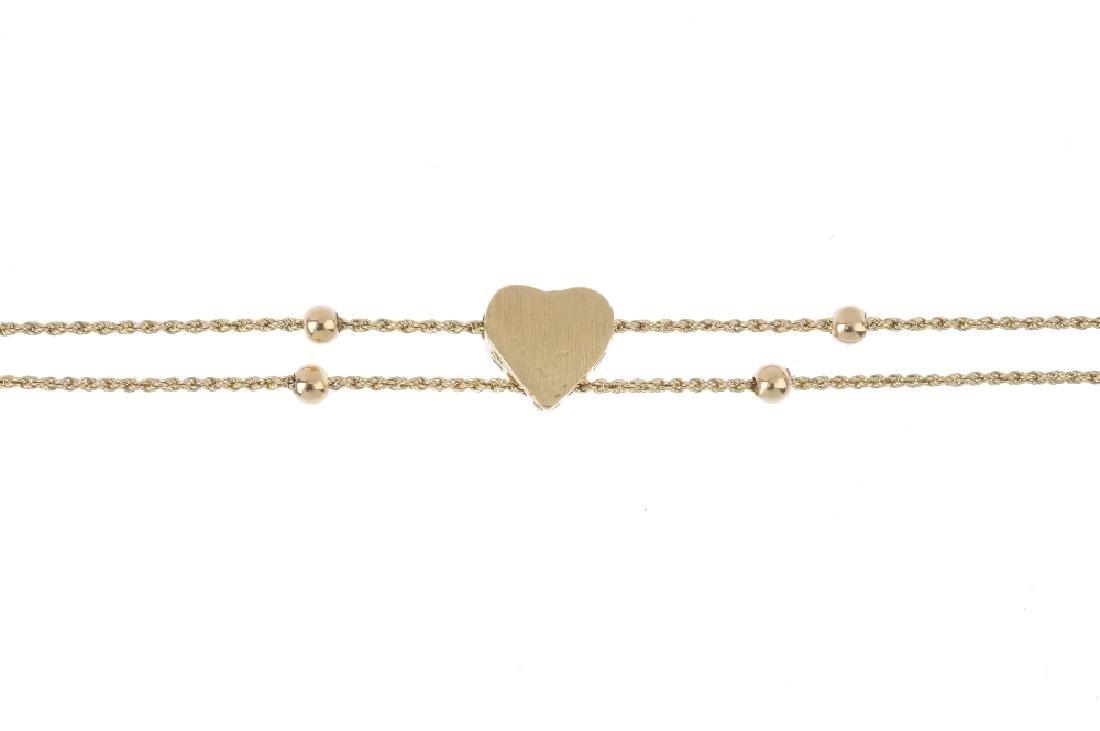 A garnet bracelet. Of bi-colour design, the heart-shape - 2