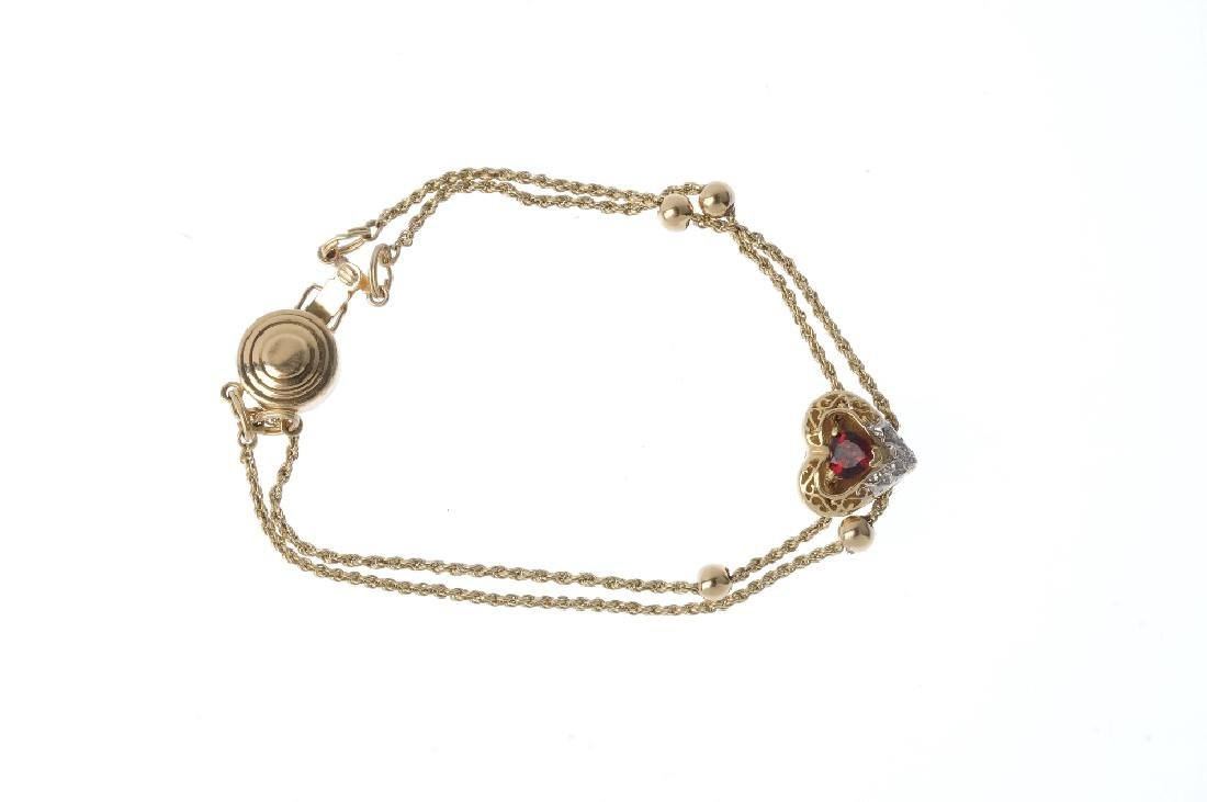 A garnet bracelet. Of bi-colour design, the heart-shape - 3